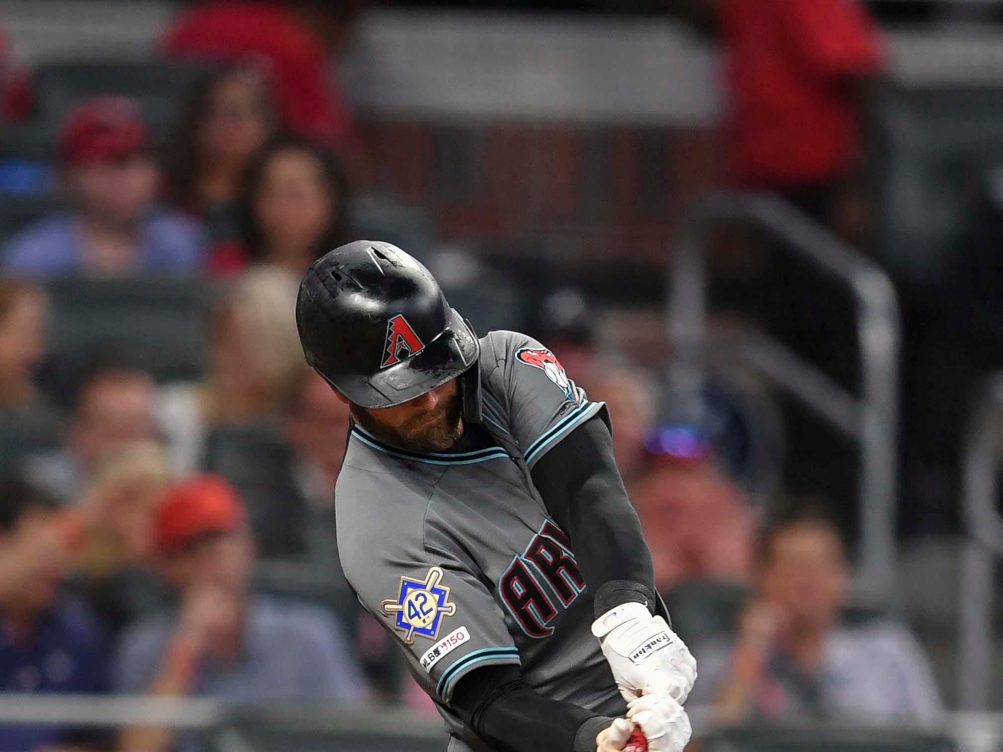 Apr 16, 2019; Atlanta, GA, USA; Arizona Diamondbacks first baseman Christian Walker (53) singles before scoring against the Atlanta Braves during the fourth inning at SunTrust Park. Mandatory Credit: Dale Zanine-USA TODAY Sports