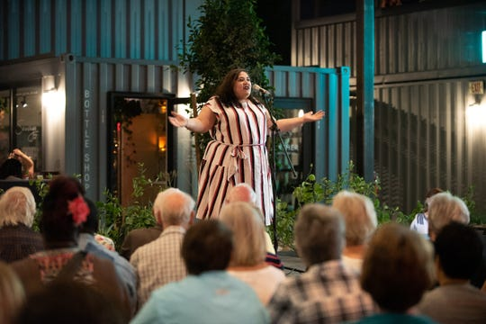 Storyteller Sarah Ventre tells her tale during the Arizona Storytellers Project Growing Up show at The Churchill in Phoenix on Tuesday, April 9, 2019.