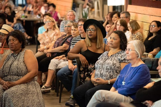 The crowd listens during the Arizona Storytellers Project Growing Up show at The Churchill in Phoenix on Tuesday, April 9, 2019.
