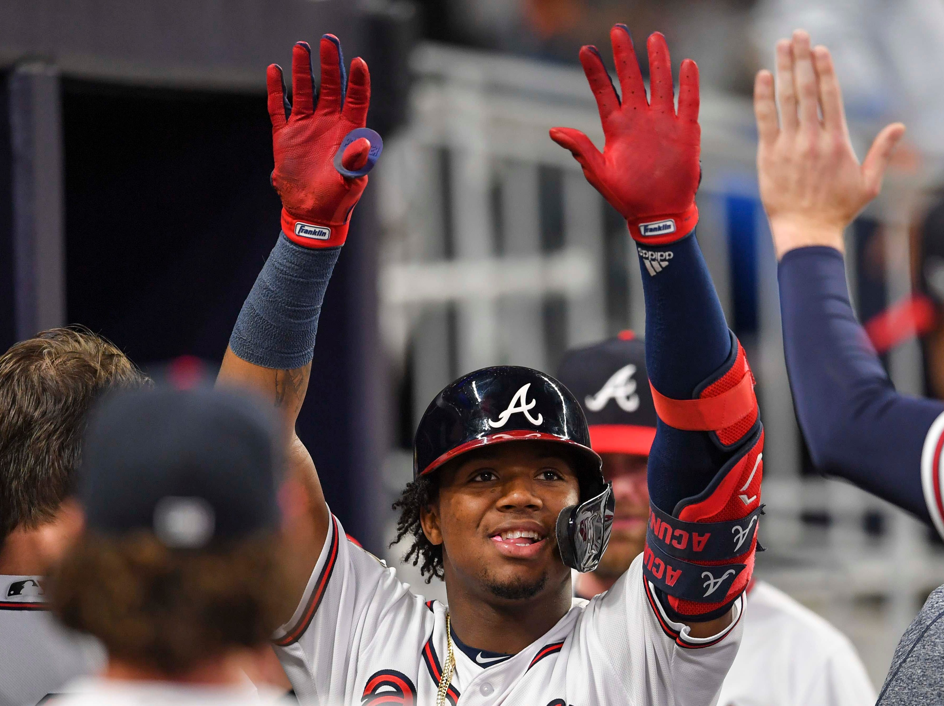 Apr 16, 2019; Atlanta, GA, USA; Atlanta Braves left fielder Ronald Acuna Jr. (13) gets high fives after hitting a home run against the Arizona Diamondbacks during the fourth inning at SunTrust Park. Mandatory Credit: Dale Zanine-USA TODAY Sports