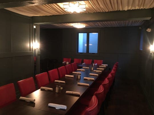 The Basement at Pomelo can be reserved for parties up to 16 and features a communal dining table.