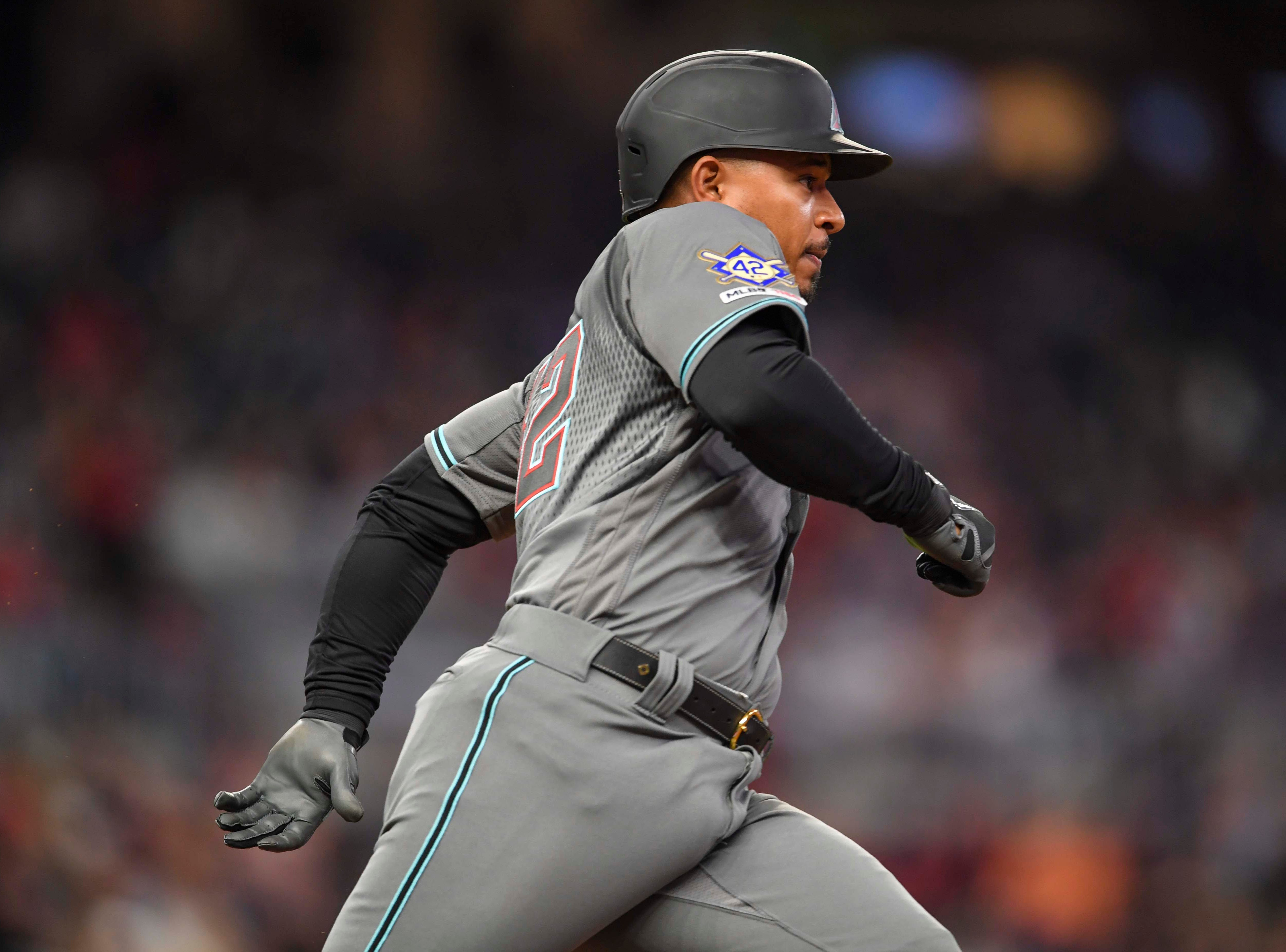 Apr 16, 2019; Atlanta, GA, USA; Arizona Diamondbacks third baseman Eduardo Escobar (5) runs after singling to score two runs against the Atlanta Braves during the seventh inning at SunTrust Park. Mandatory Credit: Dale Zanine-USA TODAY Sports