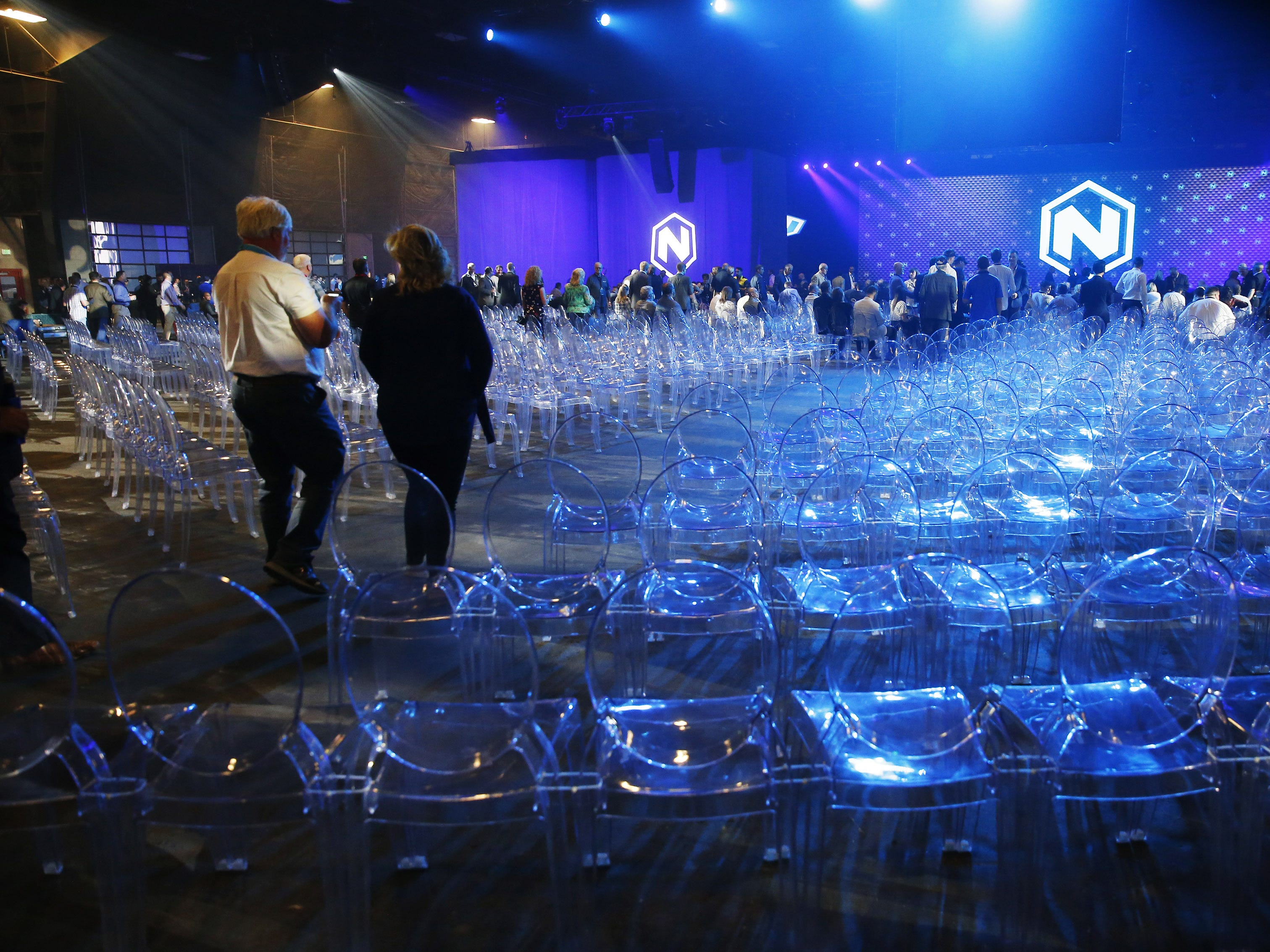 Guests take their seats at Nikola World 2019 at Westworld in Scottsdale, Ariz. April 16, 2019.