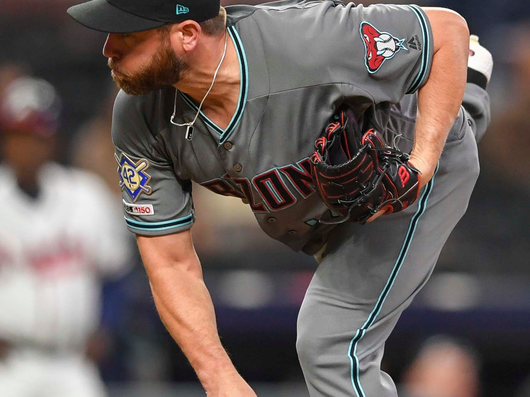 Apr 16, 2019; Atlanta, GA, USA; Arizona Diamondbacks relief pitcher Greg Holland (56) follows through on a pitch against the Atlanta Braves during the ninth inning at SunTrust Park. Mandatory Credit: Dale Zanine-USA TODAY Sports