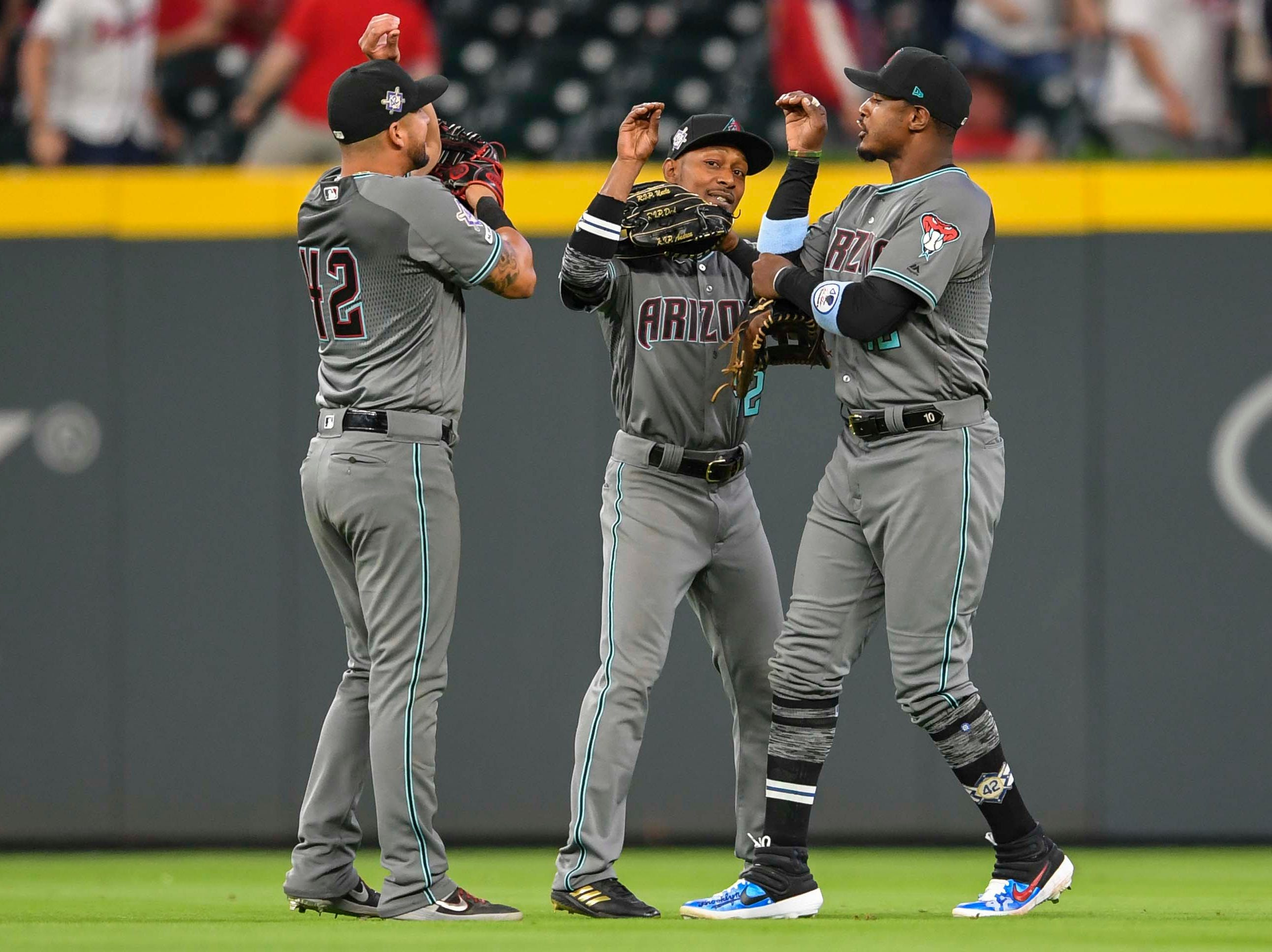 Apr 16, 2019; Atlanta, GA, USA; Arizona Diamondbacks outfielders react after defeating the Atlanta Braves at SunTrust Park. Mandatory Credit: Dale Zanine-USA TODAY Sports