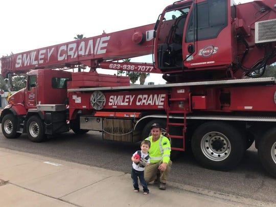 Crane operator Ryan MacLiver spent 45 minutes letting 2-year-old Bennett Bergersen explore this massive crane.