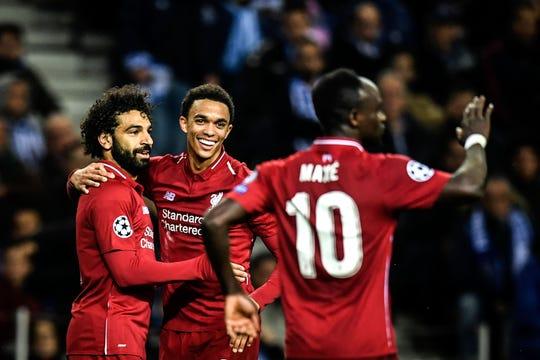 Jugadores del Liverpool celebran su goleada sobre el Porto.