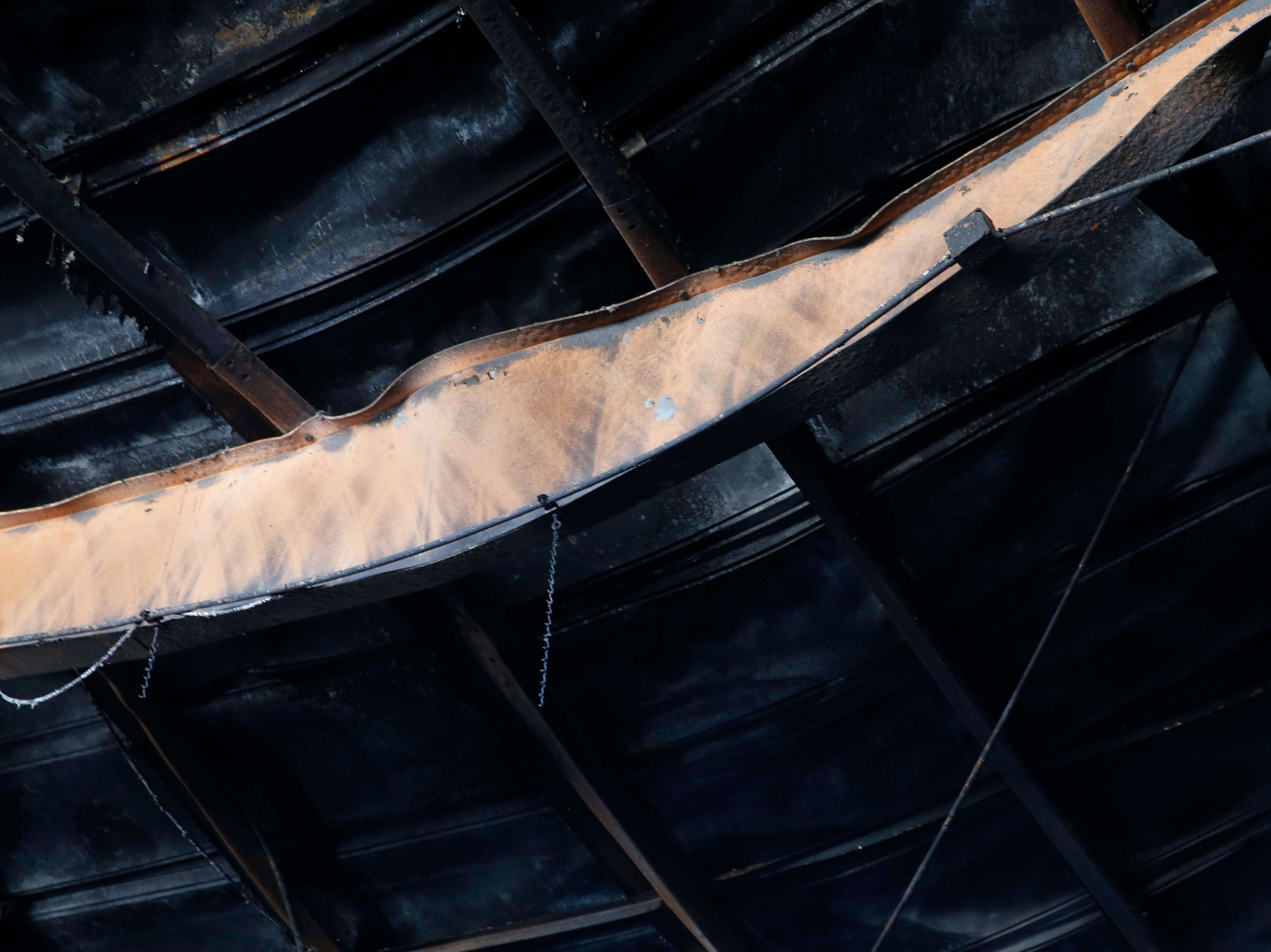 A twisted metal ceiling beam Inside Gleason Incorporated's building in the Town of Poughkeepsie on April 17, 2019. A fire in March damaged the building beyond repair.