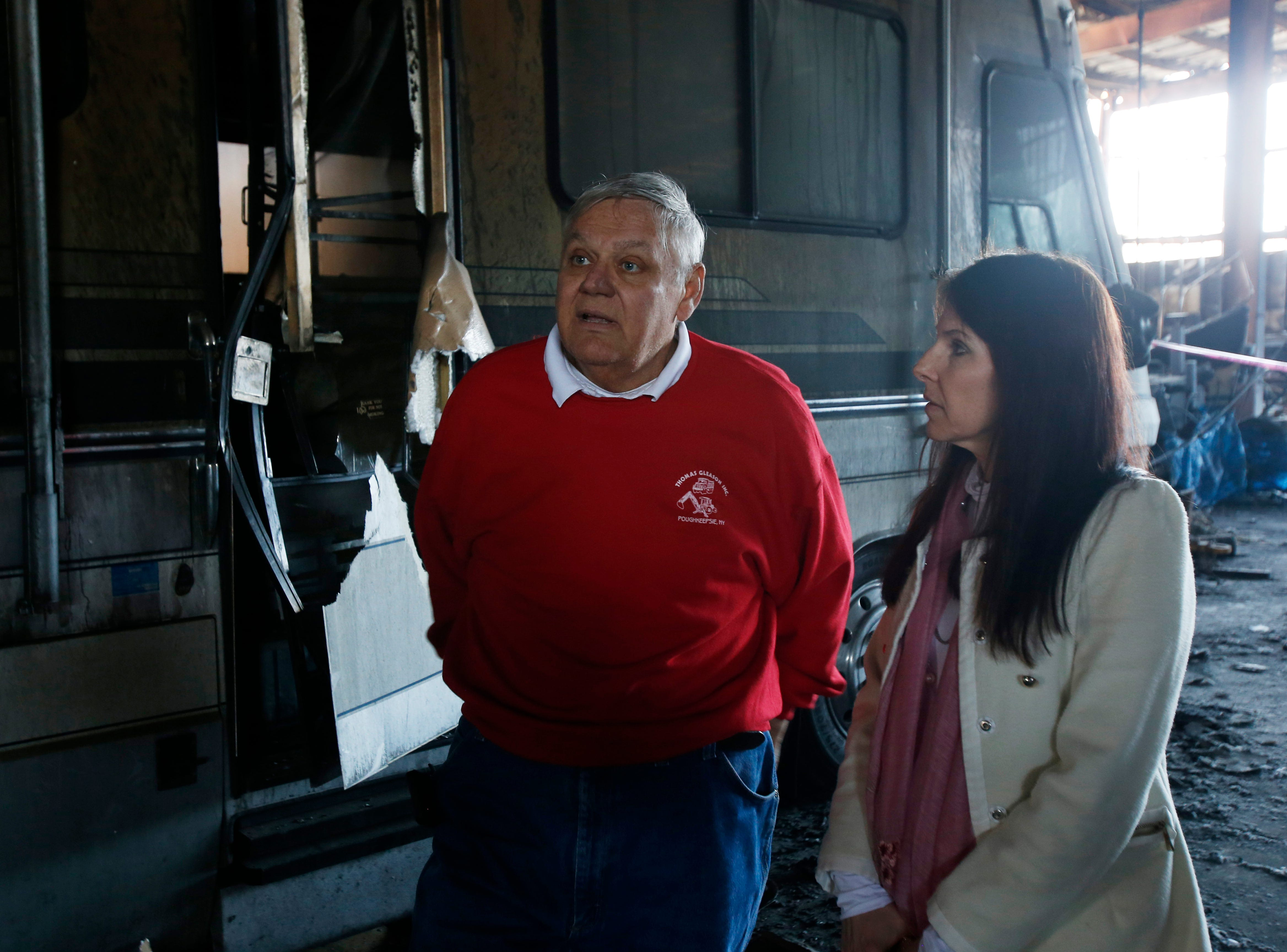 From left, Thomas and his wife Katie Gleason beside their motorhome inside their company's building in the Town of Poughkeepsie on April 17, 2019. A massive fire in March destroyed much of the building's contents and the structural integrity of the building. The couple had planned to retire and drive around the country, but due to the fire they are having to defer their plan.