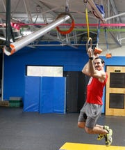 Lucio Battista practices on the warrior course at Gold's Gym in LaGrange on April 16, 2019. Battista has been on season 9 of American Ninja Warrior and is preparing to be on an upcoming season.