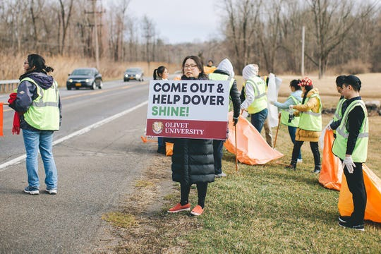 Olivet University students and members of Dover Greens are shown taking part in the Town of Dover cleanup day April 6.