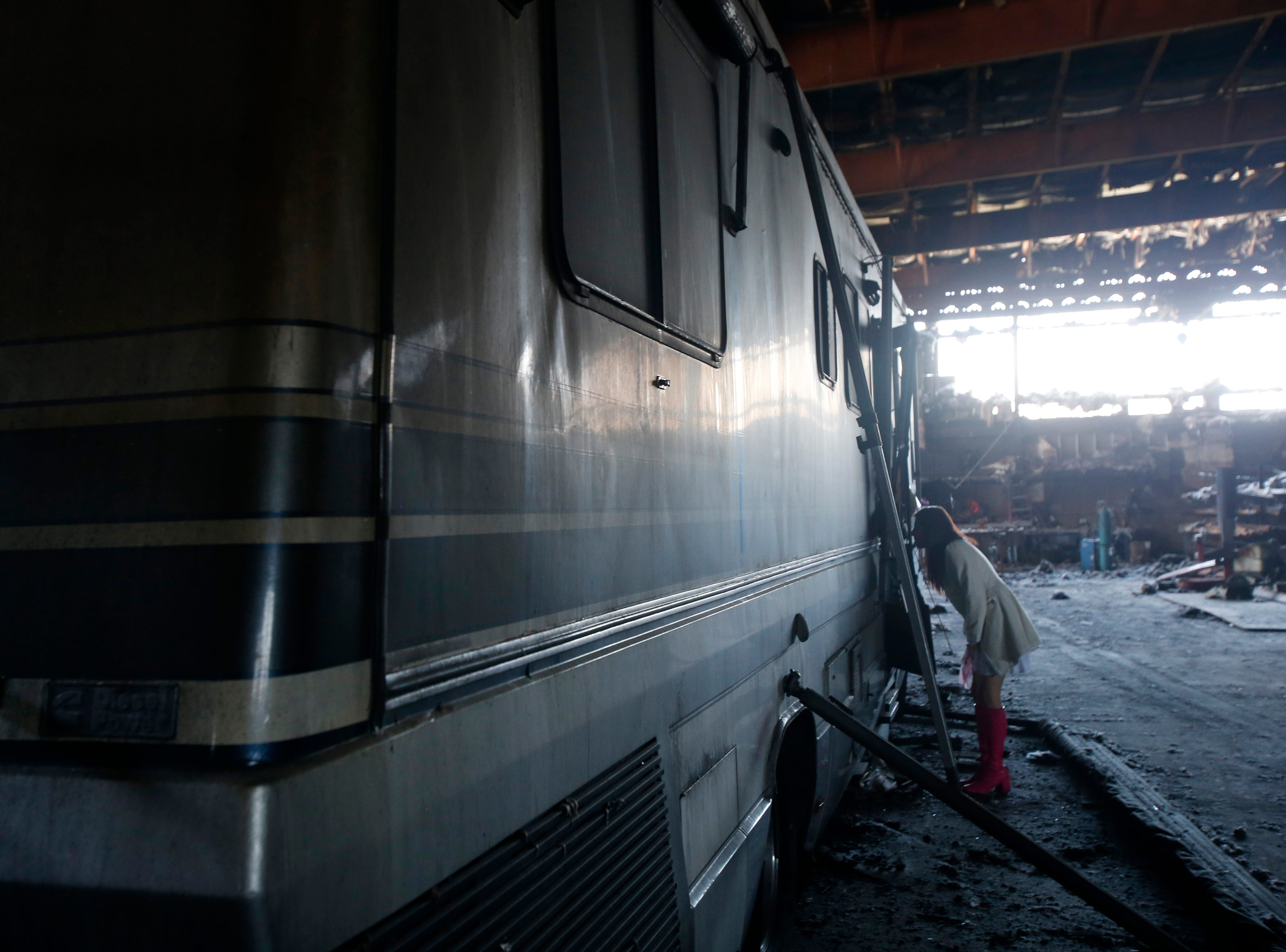 Katie Gleason takes a look inside her motorhome which is stored Inside Gleason Incorporated's building in the Town of Poughkeepsie on April 17, 2019. A fire in March damaged the building beyond repair.