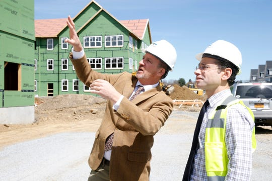 From left, Joseph T. Kirchhoff and Dr. Jason Krumholtz talk about construction details of Premier Medical Group Urology's building at Eastdale Village in the Town of Poughkeepsie on April 17, 2019.