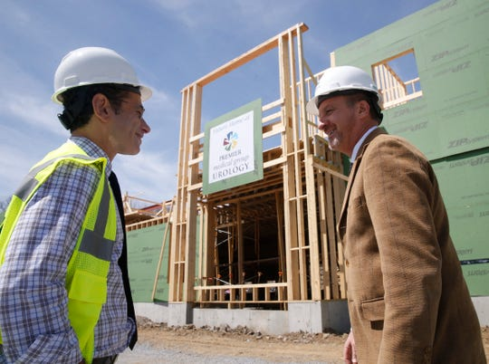 From left, Dr. Jason Krumholtz and Joseph T. Kirchhoff talk about construction details of Premier Medical Group Urology's building at Eastdale Village in the Town of Poughkeepsie on April 17, 2019.