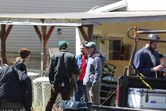"""Mark Ruffalo, center, talks while waiting to film a scene for the HBO series  """"I Know This Much is True"""" in the City of Poughkeepsie on Wednesday."""
