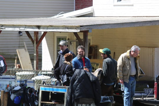 "Mark Ruffalo holds coffee and talks while waiting to film a scene for the HBO series  ""I Know This Much is True"" in the City of Poughkeepsie on Wednesday."