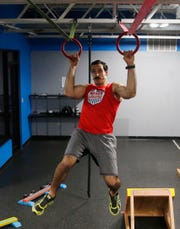 Lucio Battista works a set of rings at Gold's Gym in LaGrange on April 16, 2019. Battista has been on season 9 of American Ninja Warrior and is preparing to be on an upcoming season.