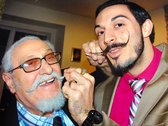 Donato and Lucio Battista show off their trademark mustaches.