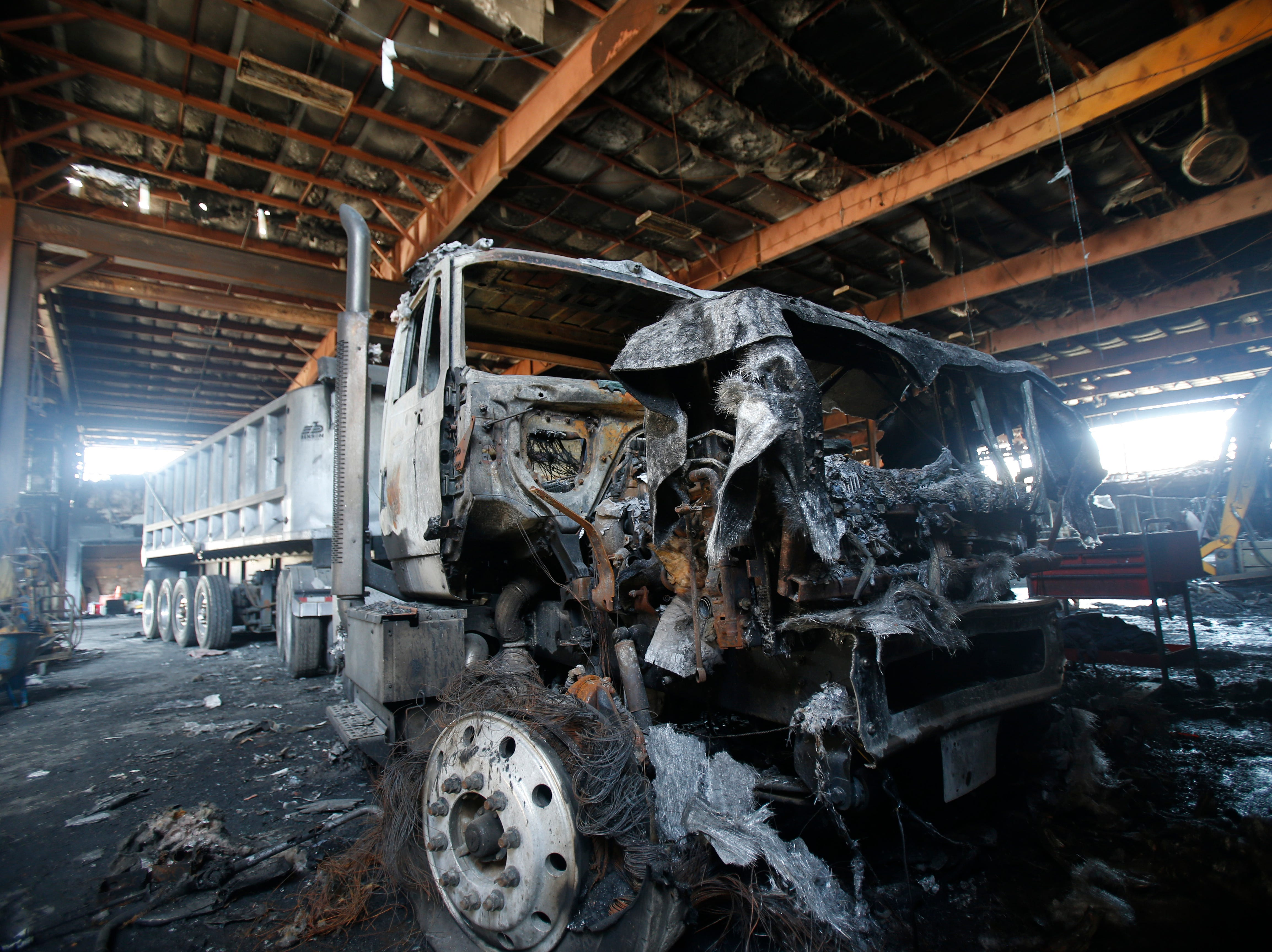 A fire damaged tractor trailer at Gleason Incorporated's building in the Town of Poughkeepsie on April 17, 2019. A fire in March damaged the building beyond repair.  The Gleason family has recently been allowed to enter the structure to assess the damage and discover what was destroyed.