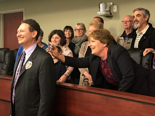 Rabbi Jeffrey Astrachan of Temple Beth Israel is the first rabbi to serve as a police chaplain with the York City Police Department, police said. Here, members of his congregation stand behind him for photos. (Liz Evans Scolforo photo)