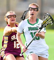 York College's Alyssa Rankin, right, controls the ball while Salisbury's Lindsey Wagner stays close behind during women's lacrosse action at York College in Spring Garden Township, Wednesday, April 17, 2019. Salisbury would win the game 10-9 in overtime. Dawn J. Sagert photo