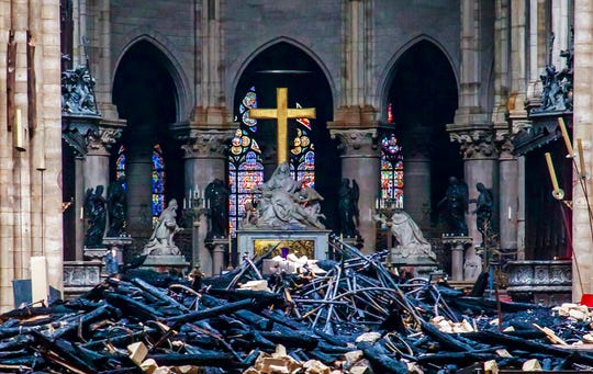 Debris is seen inside Notre Dame cathedral in Paris, Tuesday, April 16, 2019. Firefighters declared success Tuesday in a more than 12-hour battle to extinguish an inferno engulfing Paris' iconic Notre Dame cathedral that claimed its spire and roof, but spared its bell towers and the purported Crown of Christ. (Christophe Petit Tesson, Pool via AP)
