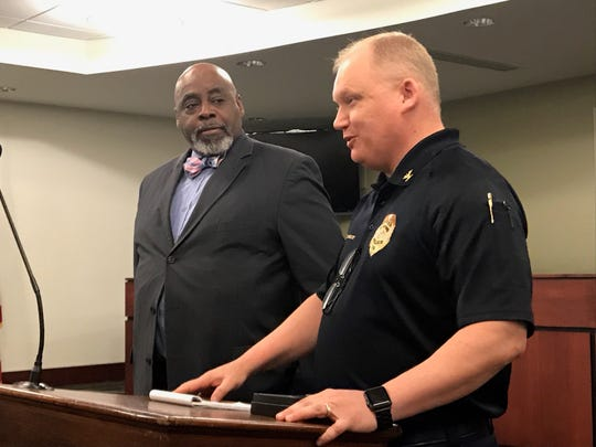 Retiring York City Police Chaplain Capt. Darnell Bowman (at left) has spent 26 years as a volunteer, providing succor to people in pain.  York City Police Chief Troy Bankert presented Bowman with a retirement badge and thanked him for his years of service on April 17, 2019. (Liz Evans Scolforo photo)