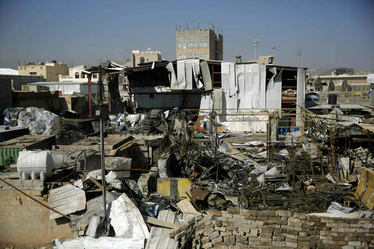FILE - This April 10, 2019, file photo shows a view of the site of an airstrike by Saudi-led coalition in Sanaa, Yemen. President Donald Trump on Tuesday vetoed a bill passed by Congress to end U.S. military assistance in Saudi Arabia's war in Yemen. (AP Photo/Hani Mohammed, File)