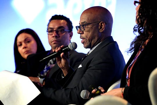 David Saunders, director of the Pennsylvania Department of Health; Office of Health Equity, speaks during a panel discussion during the Latino Health Summit at the York Fairgrounds Wednesday, April 17, 2019. Other panelists include, from left, Jessica Candito, director of customer experience for Health Partners Plans; Dr. Alexander Vigo-Valentin, director of the Federal Office of Minority Health; and moderator Stephanie Bradley of All Youth Access, Harrisburg. The statewide summit, in its second year, addresses health issues for the Latino community. It continues on Thursday. Bill Kalina photo