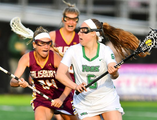 York College' Meghan Fox, seen here at right in a meeting earlier this season vs. Salisbury, had four goals and an assist on Saturday in a 13-11 win over Salisbury in the Capital Athletic Conference Tournament title match.