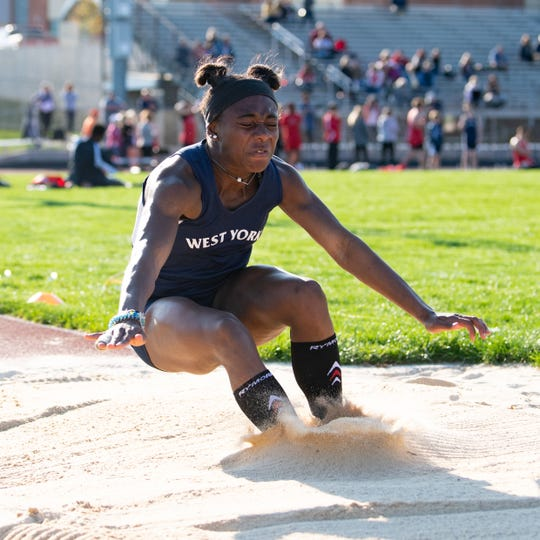 Tesia Thomas competes in the long jump during the dual track and field meet between West York and Susquehannock, April 16, 2019 at West York Area High School. The Warriors boys' and girls' teams defeated the Bulldogs.
