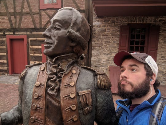 "Jon Desmarais documents part of his ""I walk York City"" campaign with the statue of General Marquis de Lafayette on West Market Street."
