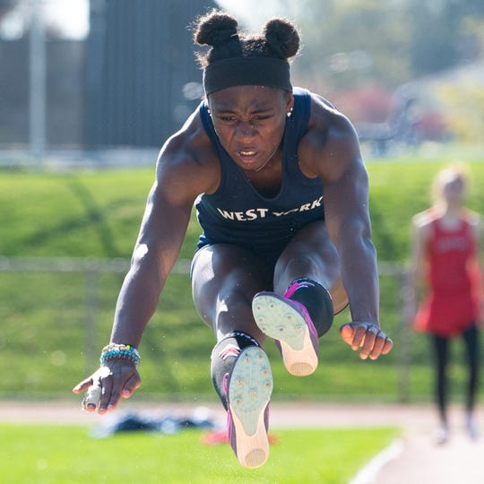Tesia Thomas soars through the air as she competes in the long jump during the dual track and field meet between West York and Susquehannock, April 16, 2019 at West York Area High School. The Warriors boys' and girls' teams defeated the Bulldogs.