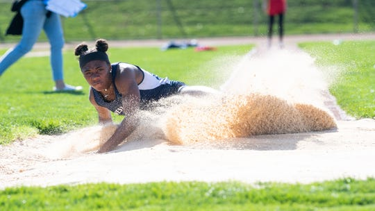 Tesia Thomas lands a fair jump during the dual track and field meet between West York and Susquehannock, April 16, 2019 at West York Area High School. The Warriors boys' and girls' teams defeated the Bulldogs.