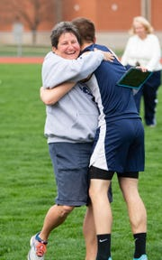 West York coach Julia Haynes hugs a runner after he secured a new personal record during the dual track and field meet between West York and Susquehannock, April 16, 2019 at West York Area High School. The Warriors boys' and girls' teams defeated the Bulldogs.