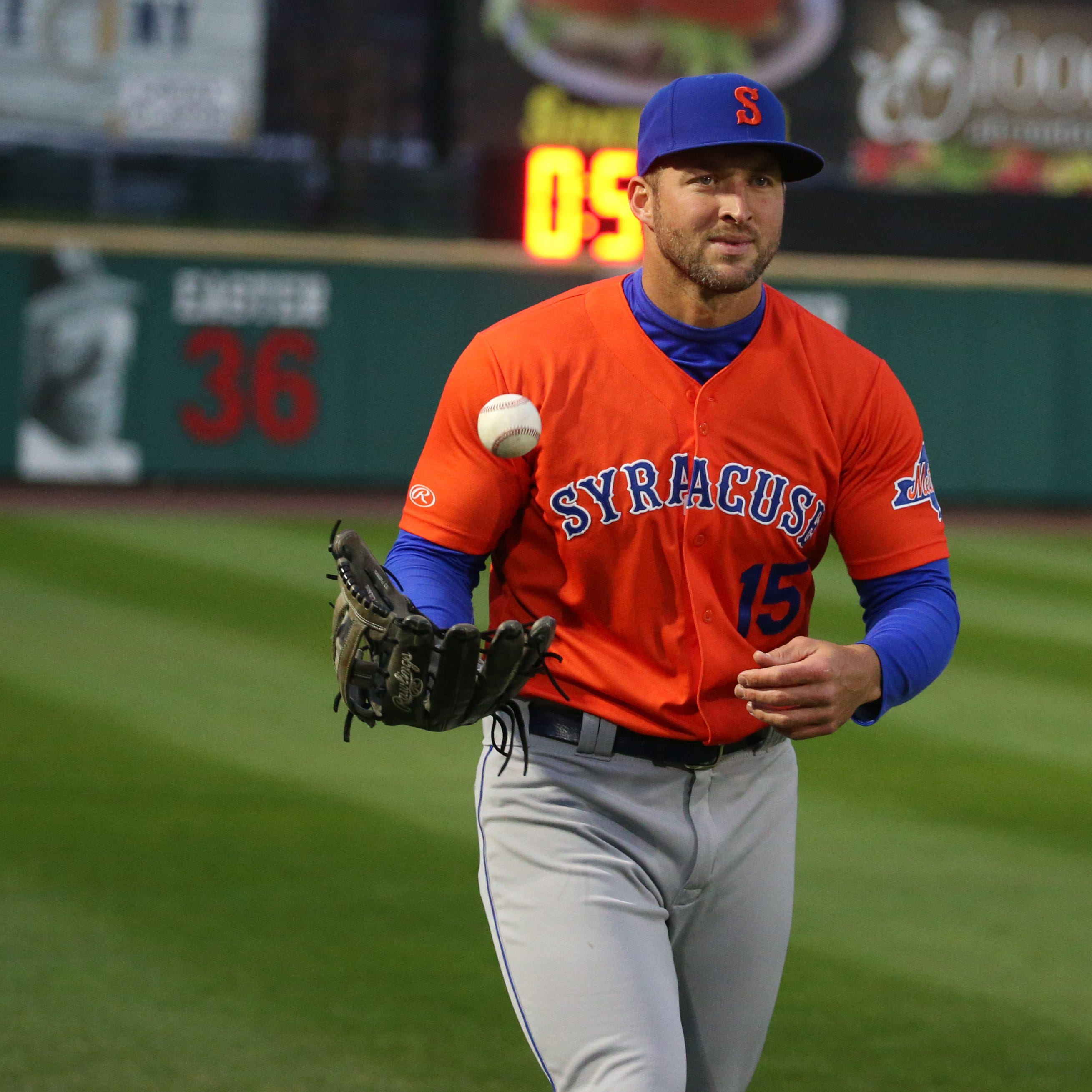 Tim Tebow sits in first game, but singles in second as Red Wings split doubleheader