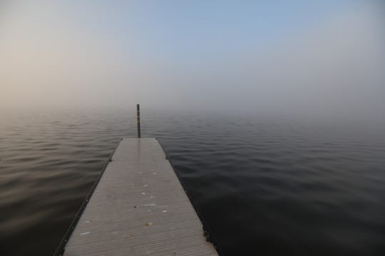 Fog shrouds Irondequoit Bay several feet from the boat ramp near the outlet bridge.
