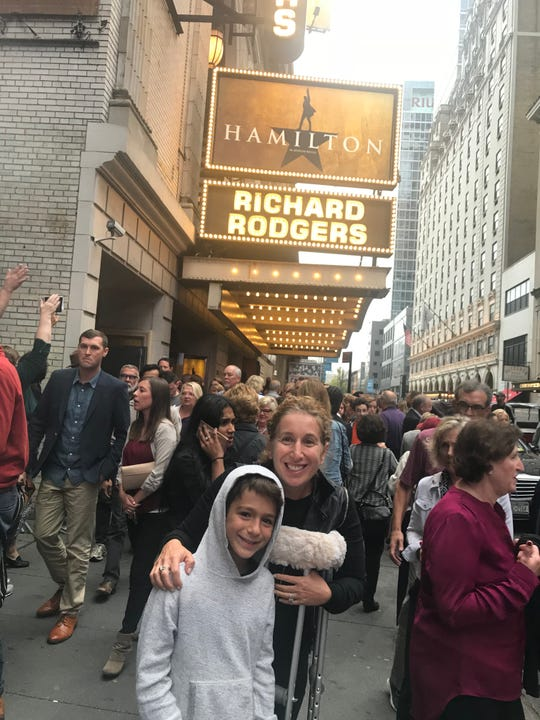 Susan Sagan Levitan and son Max outside the theater in New York.