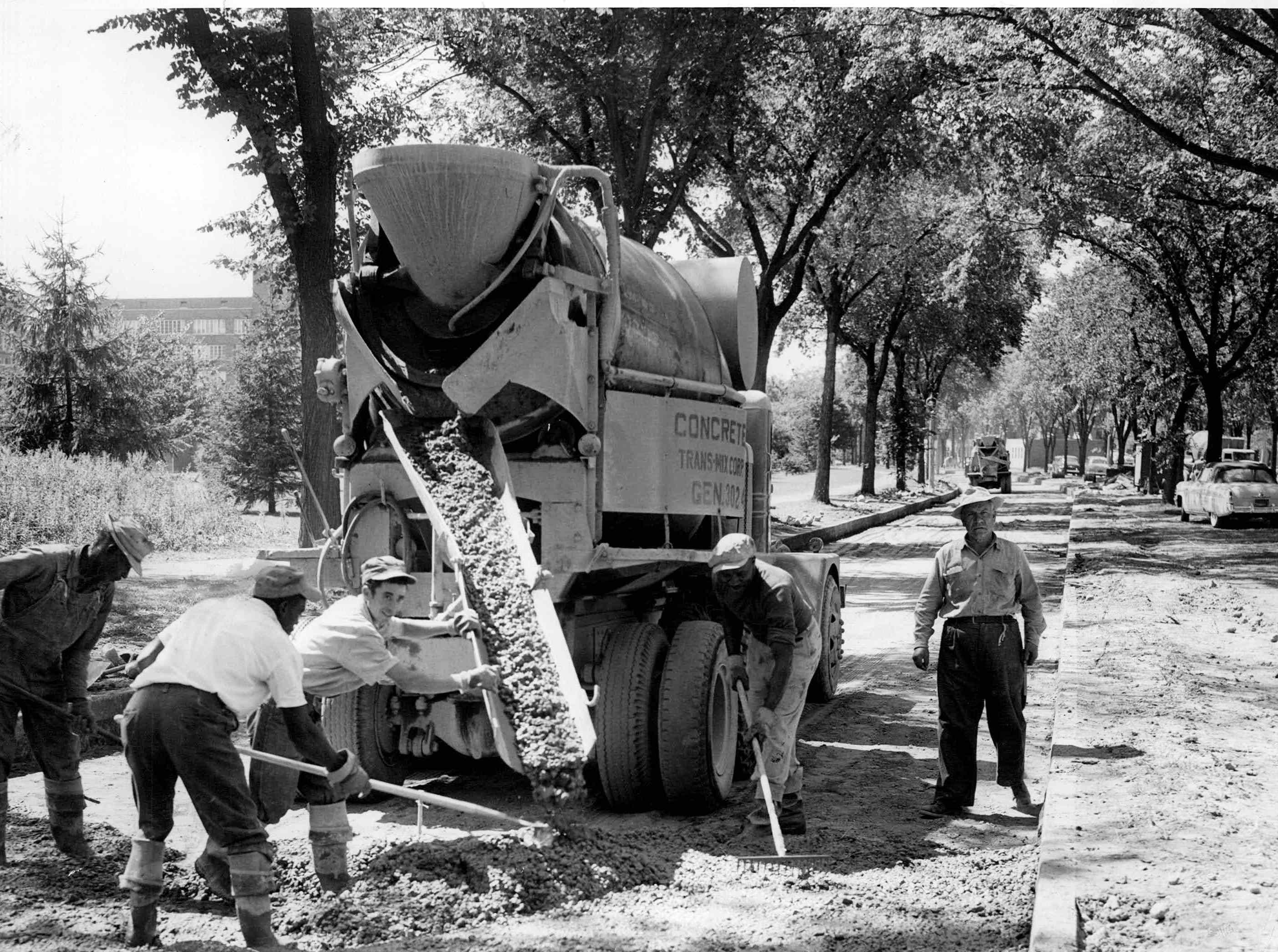 Workmen pour concrete in the south lane of Elmwood Avenue between Mt. Hope Avenue and Lattimore Road in this photo from 1954.