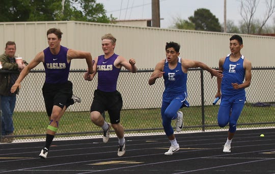 Sterling City High School's Wyatt Sisco hands off to Quinton McMullan while  Eden's Ethan Saucedo hands off to Donovan Gonzales during the boys 4x100-meter relay at the Districts 11&12-1A Area Track and Field Meet Tuesday, April 16, 2019, in Sterling City.
