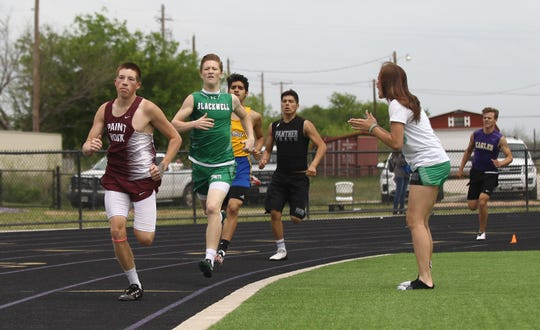 Paint Rock High School's Caden Harlow leads Blackwell's Devan Clower on the backstretch of the second lap of the boys 800 meters at the Districts 11&12-1A Area Track and Field Meet Tuesday, April 16, 2019, in Sterling City. Harlow won the race.