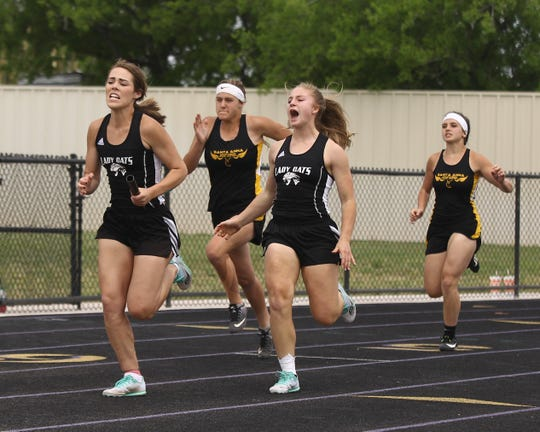 Water Valley High School's Kirstyn Greebon yells encouragement to Cayce Jackson after their first-exchange handoff in the girls 4x100-meter relay at the Districts 11&12-1A Area Track and Field Meet Tuesday, April 16, 2019, in Sterling City.