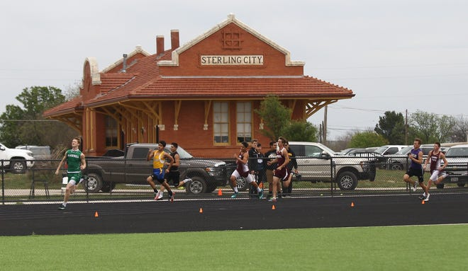 Competitors in the boys 800 meters race in front of the Sterling City depot at the Districts 11&12-1A Area Track and Field Meet Tuesday, April 16, 2019, in Sterling City.