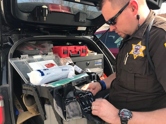 Sheboygan County Deputy Jason Brockway looks over equipment he keeps on hand that could potentially save police dog Mika's life.