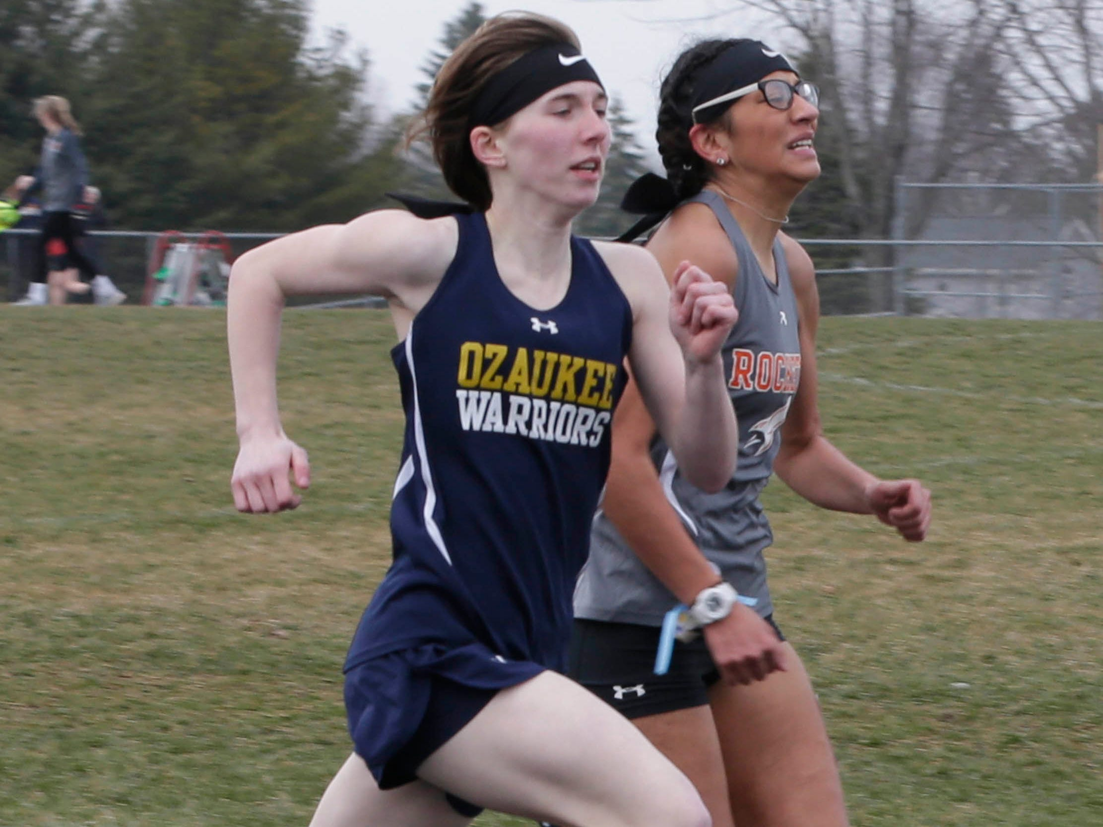 Ozaukee's Ashlee Mueller, left, competes in the final stretch of the 800 meter run with Cedar Grove-Belgium's Karen Ibarra, Tuesday, April 16, 2019, in Cedar Grove, Wis.