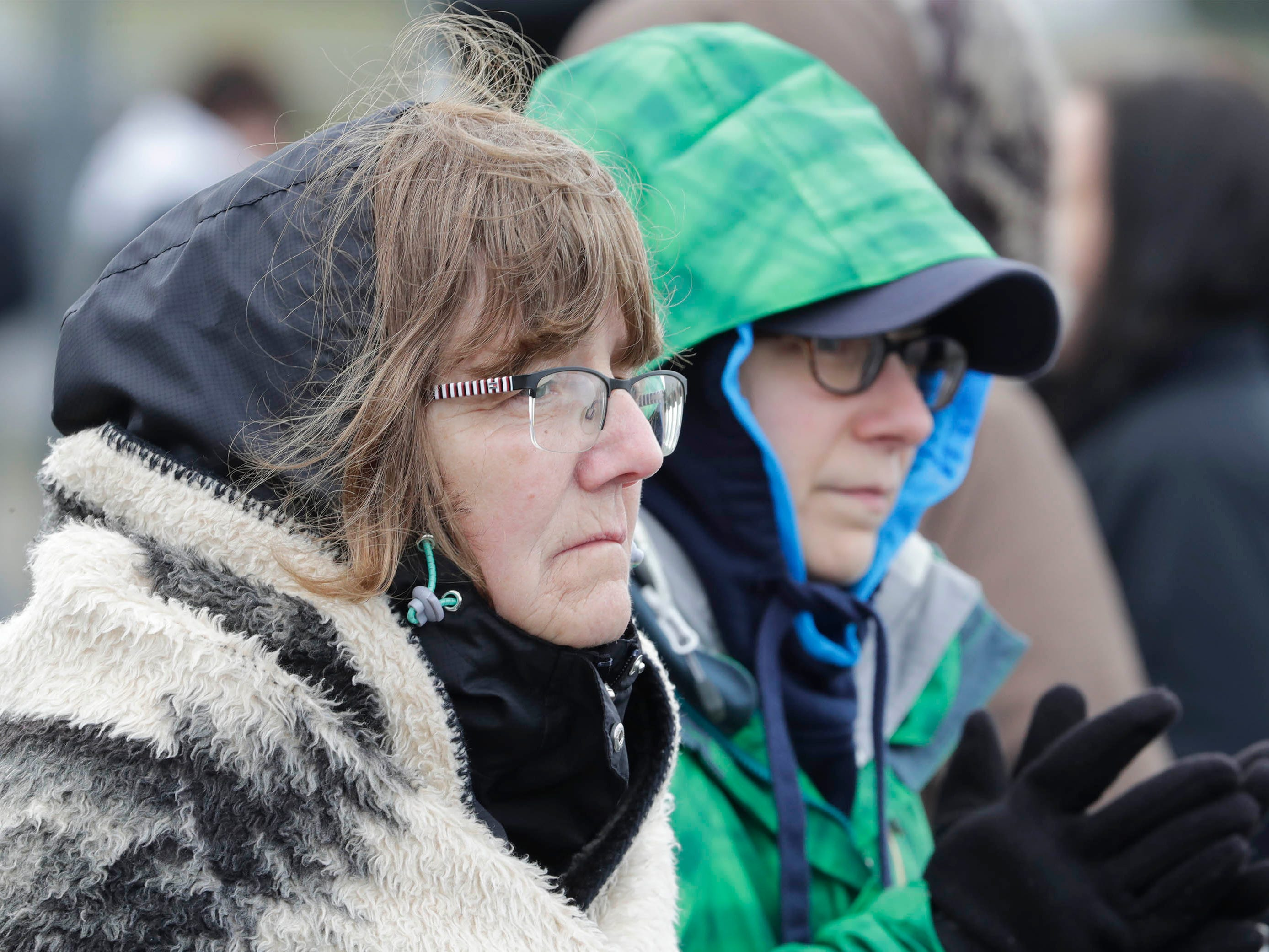 Pat McKee, of Plymouth, Wis, left, and Marisa McKee, of Fredonia, Wis., bundle for the weather at the Cedar Grove track meet, Tuesday, April 16, 2019, in Cedar Grove, Wis.