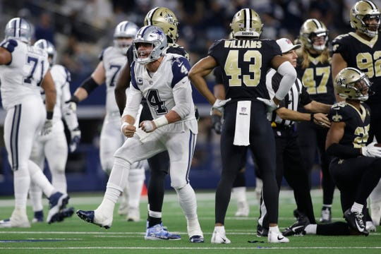 Dallas Cowboys quarterback Dak Prescott (4) reacts after getting a first down in the fourth quarter against the New Orleans Saints at AT&T Stadium last season.