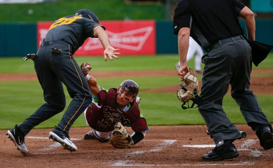 Missouri State catcher Drew Millas stretches to tag Mizzou's Tony Ortiz as the Bears take on the Tigers at Hammons Field on Tuesday, April 16, 2019.