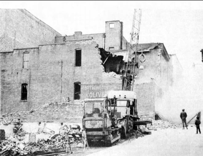 A February 1975 Staunton Leader photo of demolition for Staunton's first parking garage. Shown here is the demolition of one half of the Ast Building at the corner of Beverley and Central.