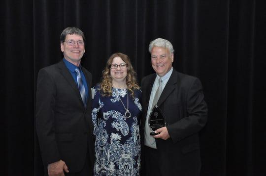 Randy Kruzel, Tami Kruzel and Vince Mohs, the BriAnna Kruzel Growing Up Big Award recipient.